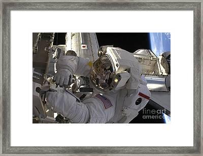 Astronaut Participates Framed Print