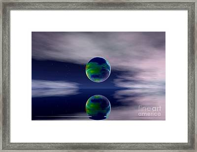 Planet Reflection Framed Print by Odon Czintos