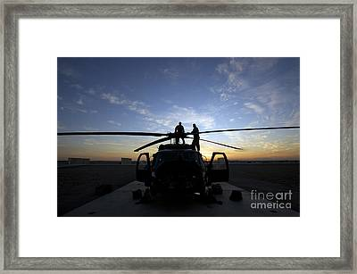 A Uh-60 Black Hawk Helicopter Framed Print by Terry Moore