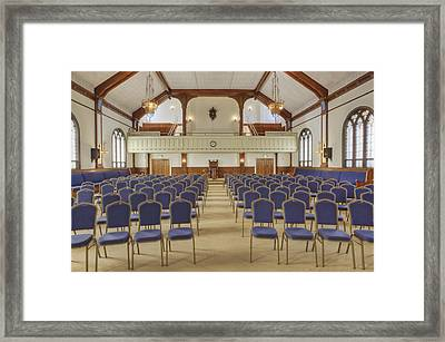 Auditorium With Blue Chairs And A Stage Framed Print