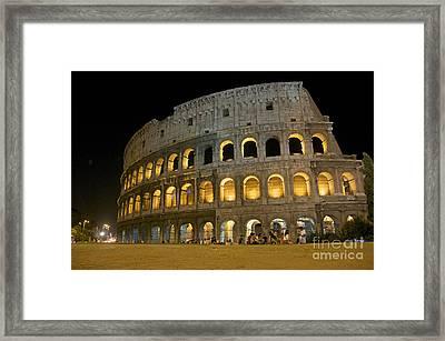 Coliseum Illuminated At Night. Rome Framed Print by Bernard Jaubert