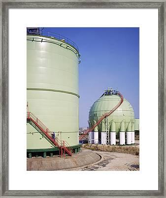 Oil Refinery Storage Tanks Framed Print by Paul Rapson