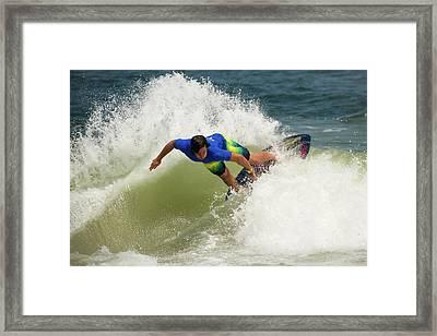 Skim Boarder Framed Print by Russ Meseroll