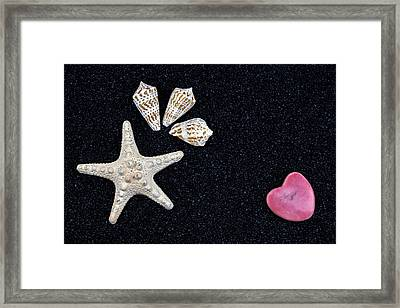 Starfish On Black Sand Framed Print by Joana Kruse