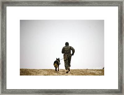 A Dog Handler And His Military Working Framed Print