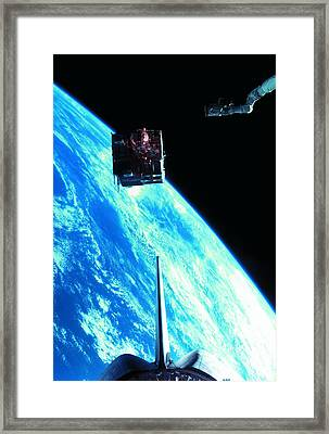 A Satellite Orbiting Above The Earth Framed Print by Stockbyte