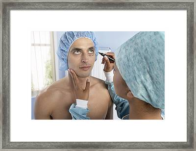 Cosmetic Surgery Framed Print by Adam Gault