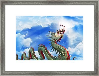 Giant Golden Chinese Dragon  Framed Print by Anek Suwannaphoom