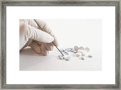 Gloved Hand And Medicinal Pills Framed Print by Blink Images