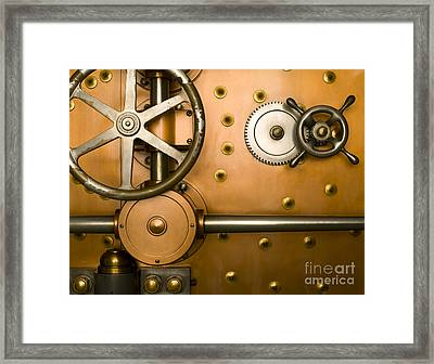 Tumbler On A Vault Door Framed Print