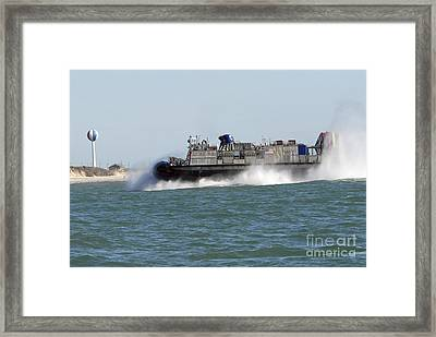 A Landing Craft Air Cushion Prepares Framed Print by Stocktrek Images