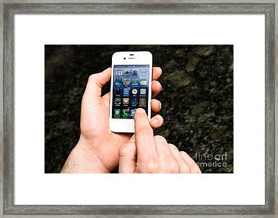 Hands Holding An Iphone Framed Print
