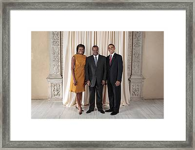 President And Michelle Obama Pose Framed Print