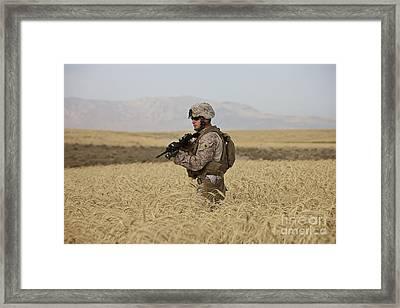 U.s. Marine Patrols A Wadi Near Kunduz Framed Print by Terry Moore
