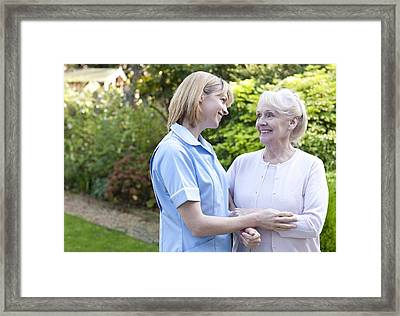 Nurse On A Home Visit Framed Print by