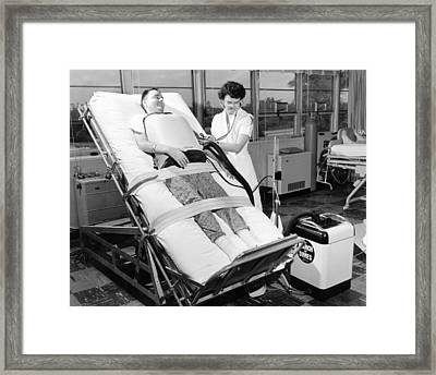 A 30 Year Old Polio Patient Wearing Framed Print by Everett