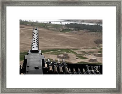 A .50-caliber Machine Gun Mounted Framed Print by Stocktrek Images