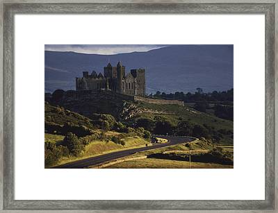 A Ancient Romanesque Castle Sits Atop Framed Print by Cotton Coulson