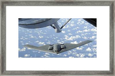 A B-2 Spirit Approaches The Refueling Framed Print by Stocktrek Images
