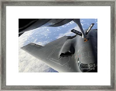 A B-2 Spirit Receives Fuel Framed Print by Stocktrek Images