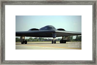 A B-2 Spirit Taxis Onto The Flightline Framed Print by Stocktrek Images