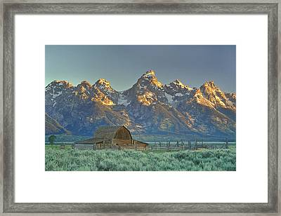 A Barn In The Rocky Mountains Framed Print by Robbie George