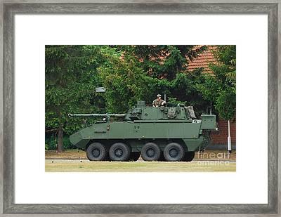 A Belgian Army Piranha IIic Framed Print by Luc De Jaeger
