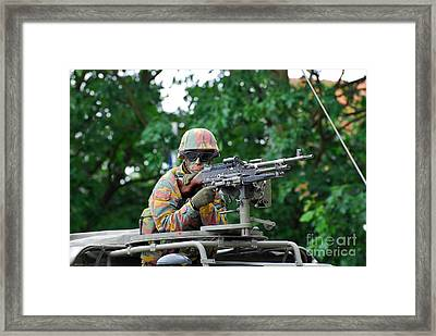 A Belgian Army Soldier Handling Framed Print by Luc De Jaeger