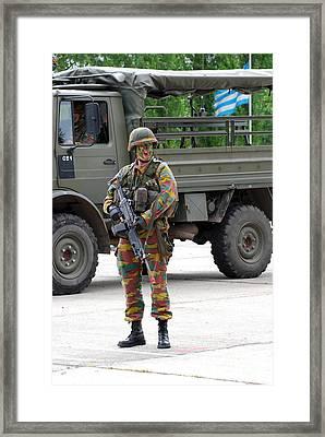 A Belgian Infantry Soldier Handling Framed Print by Luc De Jaeger