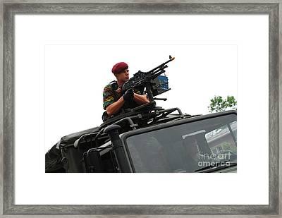 A Belgian Paratrooper Manning A Fn Mag Framed Print by Luc De Jaeger