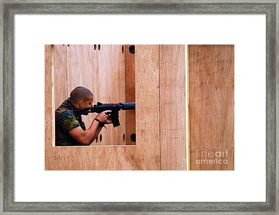 A Belgian Soldier Trying Out A Shooting Framed Print by Luc De Jaeger