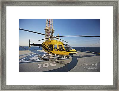 A Bell 407 Utility Helicopter Framed Print by Terry Moore