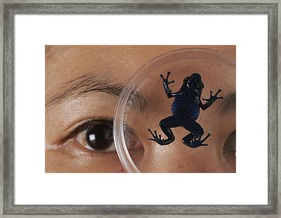 A Biologist Looks Framed Print by O. Louis Mazzatenta
