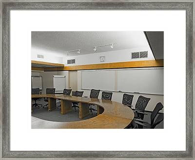 A Boardroom With An Oval Table Framed Print