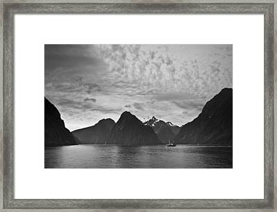 A Boat In The Water Along The Coast Framed Print by David DuChemin