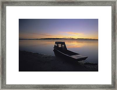 A Boat Sits On The Calm Yukon River Framed Print