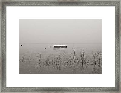 A Boat With Snow Framed Print