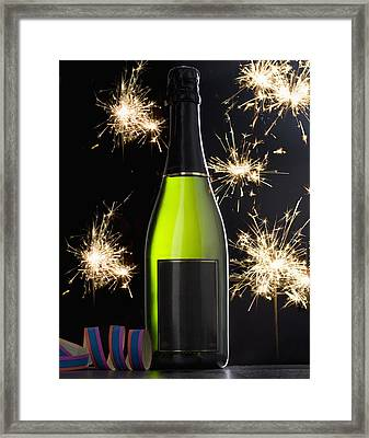 A Bottle Of Champagne And Sparklers Framed Print