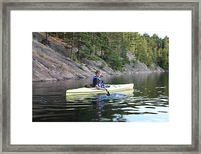 A Boy Kayaking Framed Print by Ted Kinsman