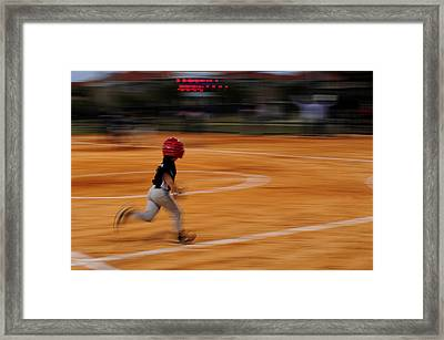 A Boy Runs During A Baseball Game Framed Print by Raul Touzon