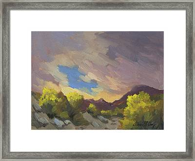 A Break In The Clouds Framed Print by Diane McClary