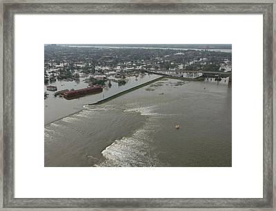 A Breech In A New Orleans Levee Floods Framed Print by Everett