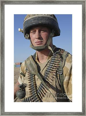 A British Army Soldier Equipped Framed Print by Andrew Chittock