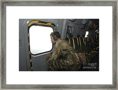 A British Army Soldier Looks Framed Print by Andrew Chittock