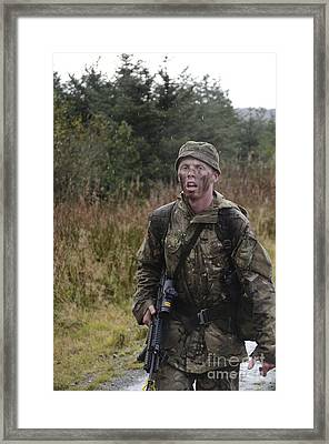 A British Soldier During Exercise Framed Print by Andrew Chittock