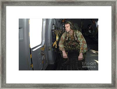A British Soldier Looks Out The Window Framed Print by Andrew Chittock