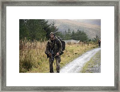 A British Soldier With Radio Framed Print by Andrew Chittock
