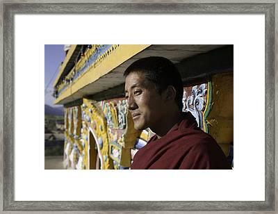 A Buddhist Monk Near The Edge Framed Print by David Evans