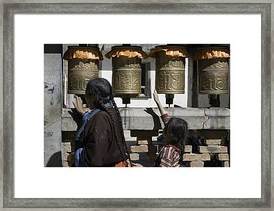 A Buddhist Woman And Child Spin Brass Framed Print by David Evans