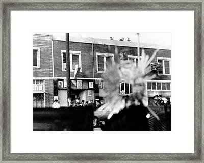 A Bullet Hole In A Storefront Window Framed Print by Everett
